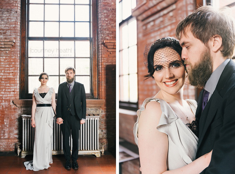 Bride and groom standing in brick building