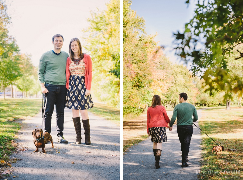 engaged couple walking in the park with dog