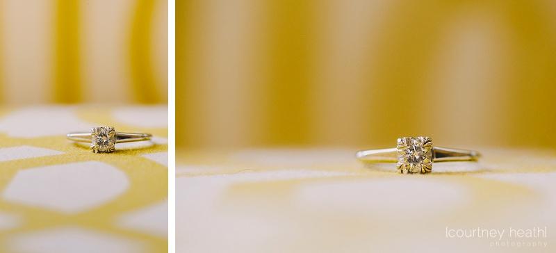 diamond engagement ring on yellow pillow bokeh