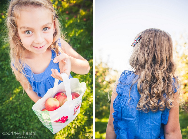 Girl showing her bag of apples