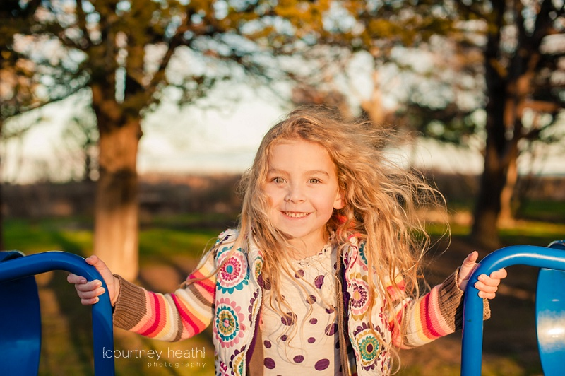 Beautiful girl with long curly hair during golden hour
