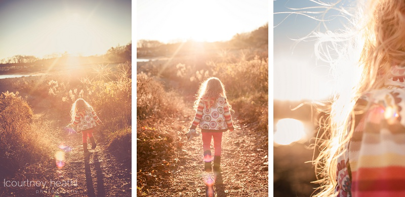 Girl with long curly hair walking into the sunset