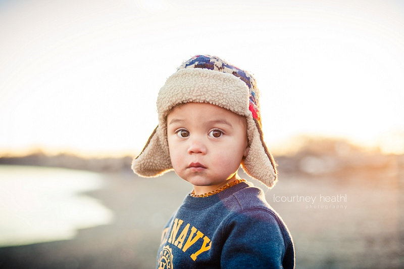 Young boy with brown eyes wearing pilot hat