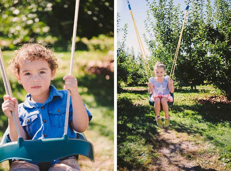 Brother and sister swinging on swings