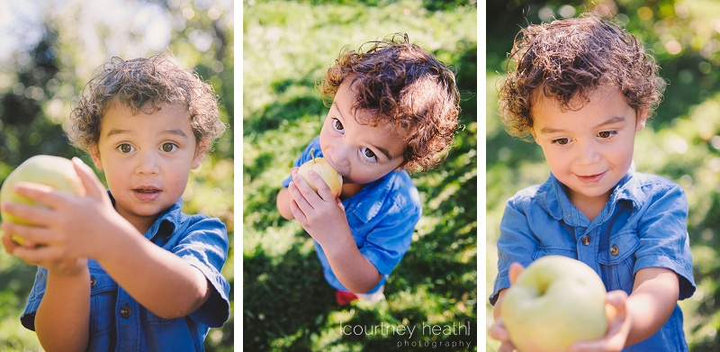 Curly haired boy eating an apple