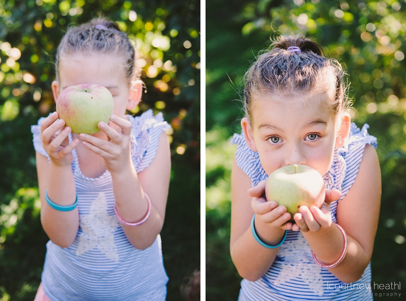 Young girl holding a green apple