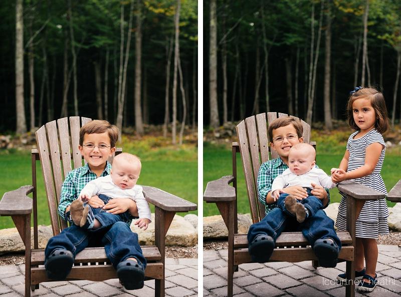 children sitting in Adirondack chair