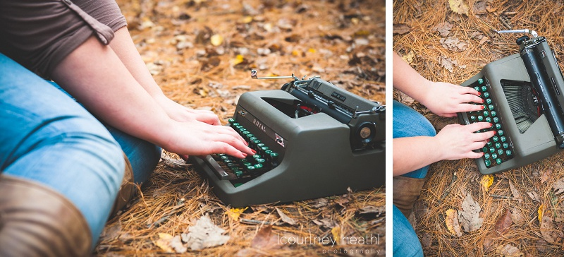 Girl sitting on forest floor typing on typewriter