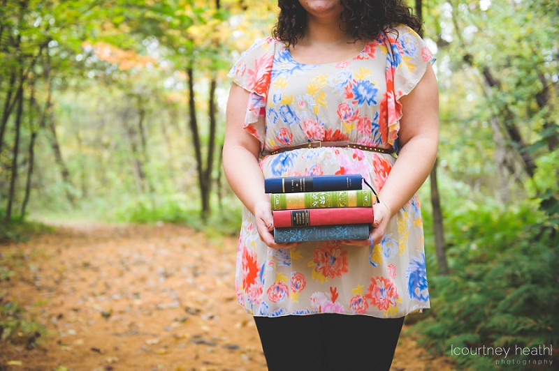 senior girl holding colorful books