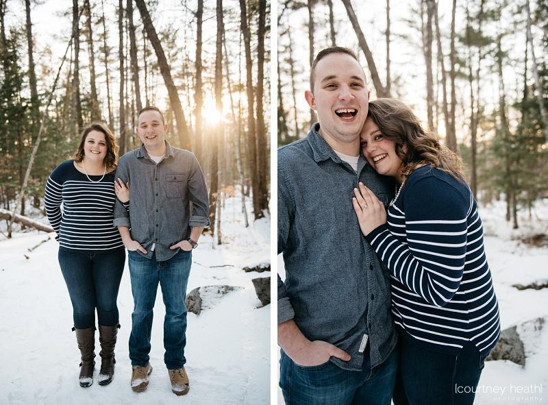 Happy couple wearing blue in snowy winter woods
