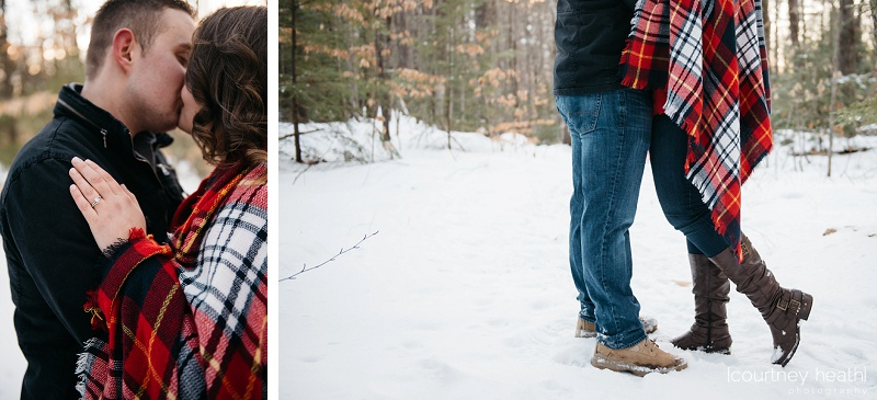 engaged couple kissing in snowy nh woods