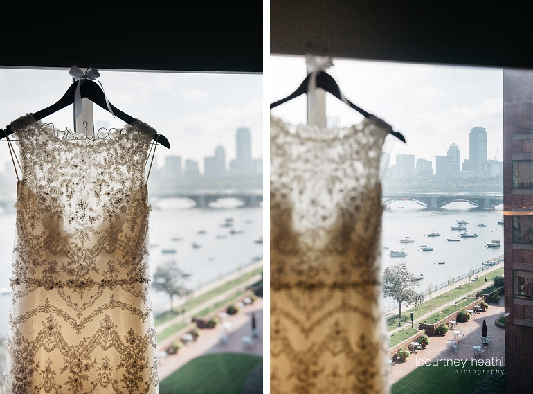 Detailed wedding dress on personalized hanger in front of Boston skyline at Royal Sonesta