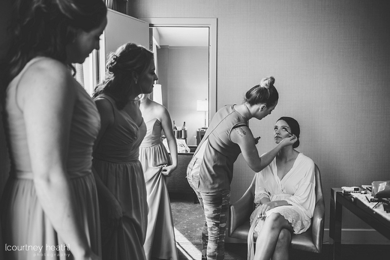 Bridesmaids watch bride get her makeup done at Royal Sonesta Boston