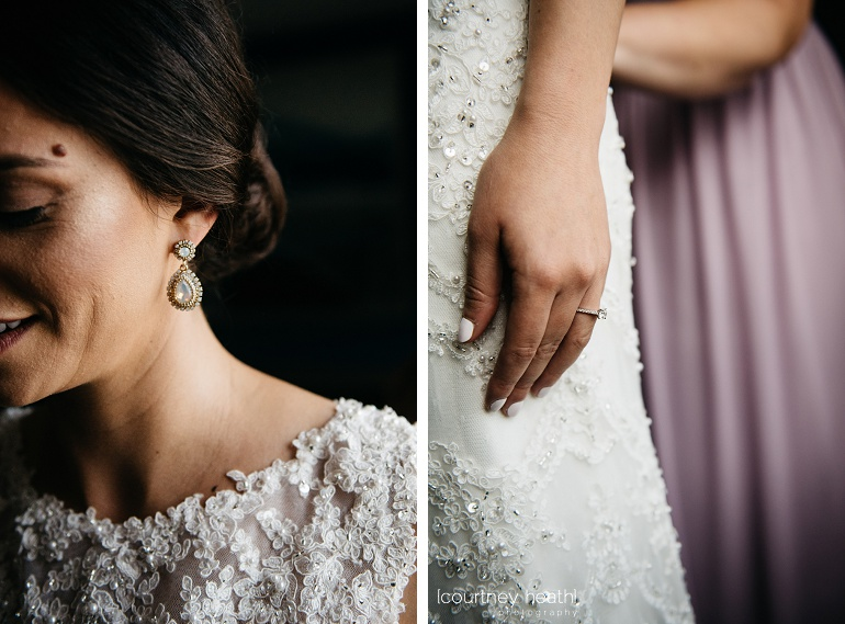 Bride wearing intricate wedding dress, earrings and engagement ring at Royal Sonesta Boston