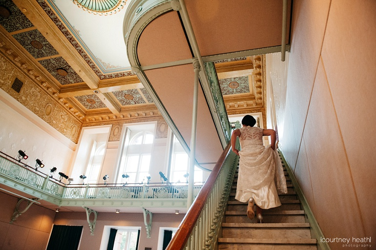 Bride climbs stairs at Cambridge Multicultural Arts Center Boston