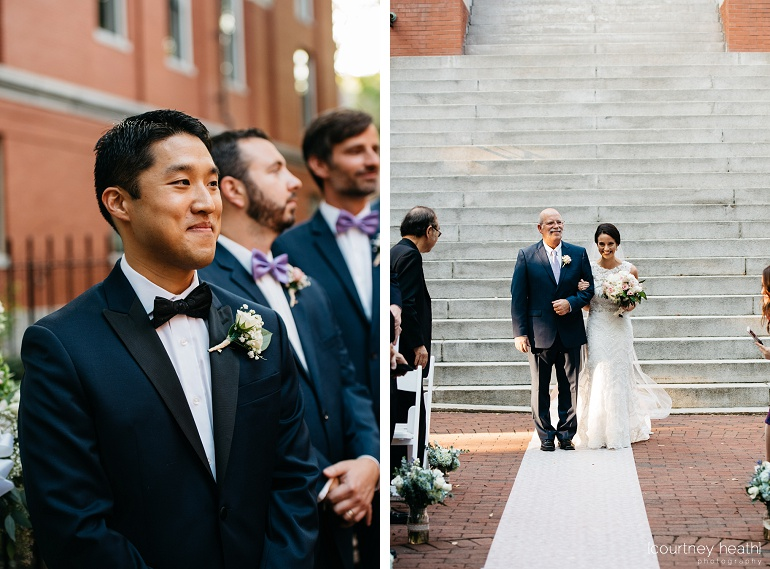 Groom smiles at his bride as she walks down the aisle with her father