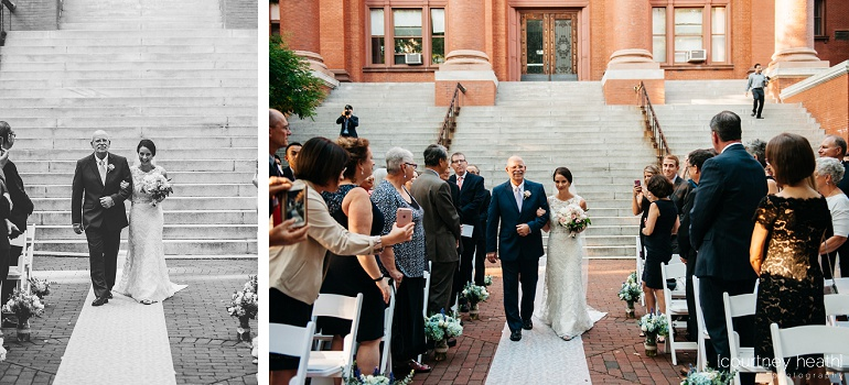 Bride walks down aisle with father at Cambridge Multicultural Arts Center