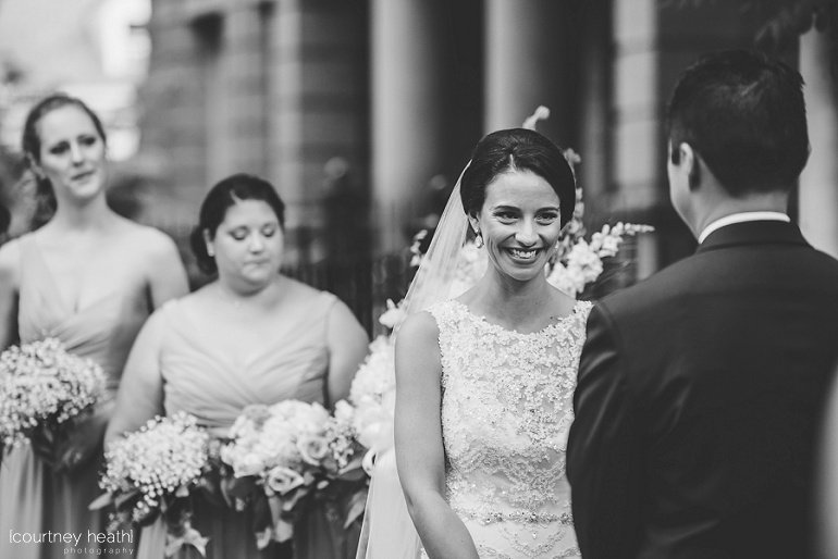 Black and white image of bride smiling at her groom at Cambridge Multicultural Arts Center