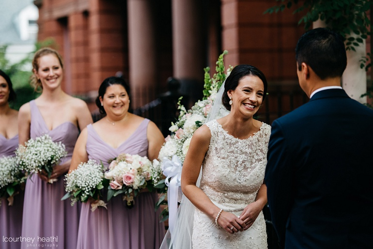 Beautiful bride laughing during ceremony at Cambridge Multicultural Arts Center