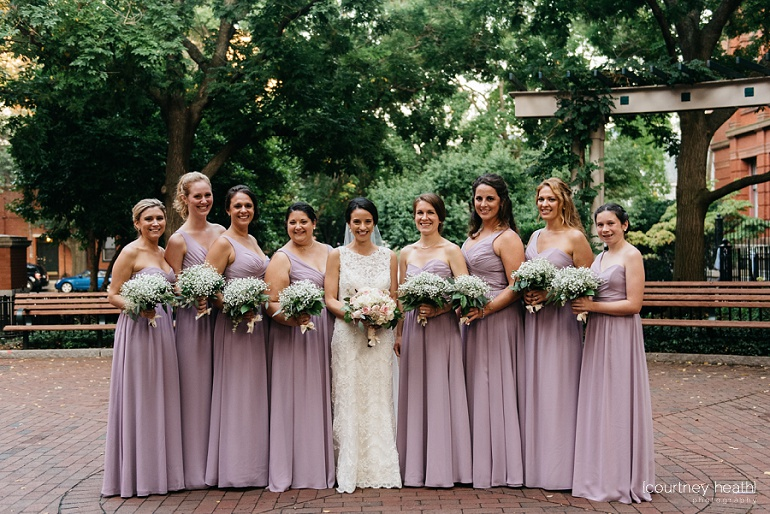 Bridesmaids in lilac dresses in courtyard of Cambridge Multicultural Arts Center
