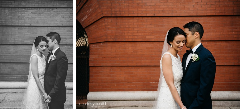 Bride and groom enjoy moment alone in front of brick building in Boston