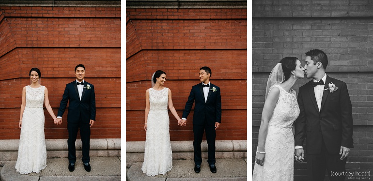 Bride and groom in front if brick building in Boston